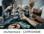 enjoying cheese and wine at a... | Shutterstock . vector #1259024008