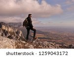 mountaineer boy  with backpack... | Shutterstock . vector #1259043172