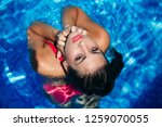 fashion girl with waterproof... | Shutterstock . vector #1259070055