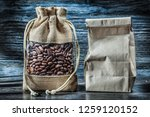 beans of coffee in sack and... | Shutterstock . vector #1259120152
