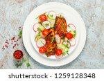 fried chicken fillet and fresh...   Shutterstock . vector #1259128348
