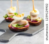 Stock photo tradition danish open sandwich smorrebrod with herring egg cucumber and onions dark bread 1259129902