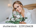 the blonde bride sits on a...   Shutterstock . vector #1259136628