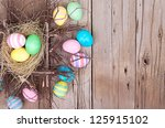 Easter Eggs In Nest On Rustic...
