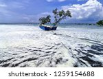 the waves of the sea produce... | Shutterstock . vector #1259154688