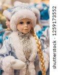 christmas girl dolls  snow...   Shutterstock . vector #1259173552