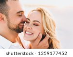 a bearded man and a blond woman ... | Shutterstock . vector #1259177452