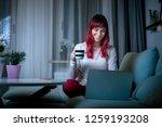 cheerful woman browsing... | Shutterstock . vector #1259193208