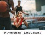 female athlete doing squats on... | Shutterstock . vector #1259255068