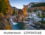 Historic wooden powerhouse called the Crystal Mill in Colorado with colorful autumn colors. It is located on an outcrop above the Crystal River in Crystal ghost town and was built in 1892. - stock photo