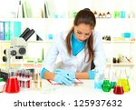 young scientist looking into ... | Shutterstock . vector #125937632