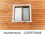 the window in the wooden wall... | Shutterstock . vector #1259376568