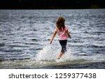 girl dancing in flooded water... | Shutterstock . vector #1259377438