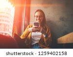 cheerful hipster girl in... | Shutterstock . vector #1259402158