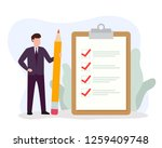 businessman holding big pencil... | Shutterstock .eps vector #1259409748