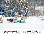 little adorable girls sledding... | Shutterstock . vector #1259513938