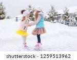 adorable little girls skating... | Shutterstock . vector #1259513962