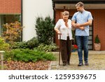 happy senior lady with walking... | Shutterstock . vector #1259539675