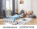 pouf  rugs and plush toy in... | Shutterstock . vector #1259547418