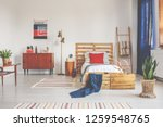 wooden bed with white bedding... | Shutterstock . vector #1259548765
