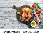 baked chicken with spices on a... | Shutterstock . vector #1259570335