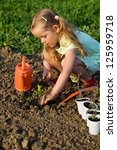 little girl planting tomato... | Shutterstock . vector #125959718
