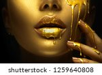 gold paint smudges drips from... | Shutterstock . vector #1259640808