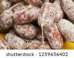 plenty of sausages in the market   Shutterstock . vector #1259656402