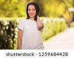 happy young beautiful woman... | Shutterstock . vector #1259684428