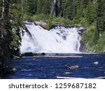 Small photo of Side close up of Lewis Falls falling to the Lewis River at the Yellowstone National Park in Wyoming, USA.