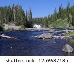 Small photo of Scenic shot of Lewis River with Lewis Falls at Yellowstone National Park, Wyoming, USA
