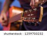 Guitar Player Tweaking The...