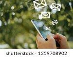 woman hand using smartphone to... | Shutterstock . vector #1259708902