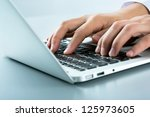 closeup of businessman typing... | Shutterstock . vector #125973605