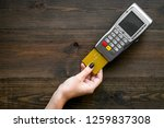 pay by payment terminal. woman... | Shutterstock . vector #1259837308