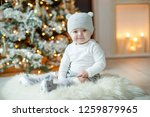 little baby at  hristmas | Shutterstock . vector #1259879965