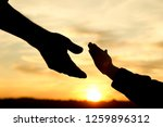 silhouette the parent holds the ... | Shutterstock . vector #1259896312