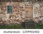old wooden closed door and... | Shutterstock . vector #1259902402