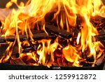 firewood in the fire background | Shutterstock . vector #1259912872