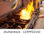chef cooking with flame on his...   Shutterstock . vector #1259922142