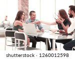 group of employees discusses... | Shutterstock . vector #1260012598