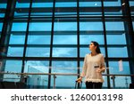 woman smiling waiting her... | Shutterstock . vector #1260013198