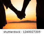 couple hold hands in summer... | Shutterstock . vector #1260027205