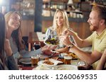 friends having dinner at... | Shutterstock . vector #1260069535