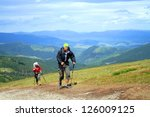 summer hiking in the mountains. | Shutterstock . vector #126009125