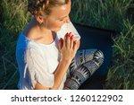 girl meditates sitting on a...   Shutterstock . vector #1260122902