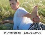 girl doing yoga on a beautiful...   Shutterstock . vector #1260122908