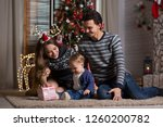 family sits with the baby... | Shutterstock . vector #1260200782