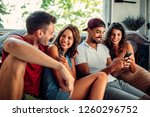 cropped shot of four happy...   Shutterstock . vector #1260296752