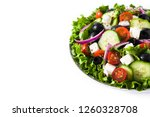 fresh greek salad in plate with ... | Shutterstock . vector #1260328708